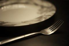 Тонизированная вилка в monochrome плиты Стоковые Фото
