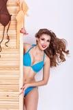 Тонкая девушка в купальнике стоковые фото