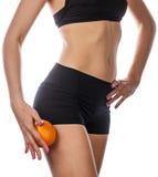 Тонкая диаграмма женщина держит апельсин Стоковое Изображение