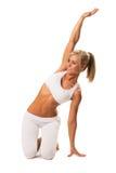 Тонкая сексуальная женщина делая протягивающ тренировку Стоковое фото RF