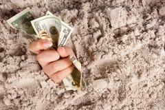 тонуть деньги стоковое изображение rf