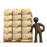 Торговля товара, коричневый figurine рядом с полным паллетом Стоковые Фотографии RF