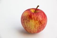 Торжественное яблоко на белой предпосылке Стоковые Фотографии RF