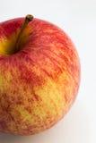 Торжественное яблоко на белой предпосылке Стоковые Изображения