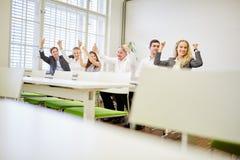 Торжествующие бизнесмены обхватывают их кулаки Стоковое Изображение RF