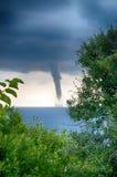 Торнадо над морем Стоковое Изображение