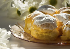 Торты - cream слойки и eclairs Стоковые Изображения RF