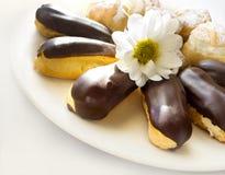 Торты - cream слойки и eclairs Стоковое Изображение