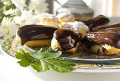 Торты - cream слойки и eclairs Стоковые Изображения
