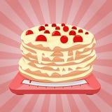 Торт на масштабах Стоковые Фотографии RF