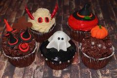 Торт на хеллоуине - изверги семьи Стоковая Фотография