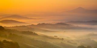 Тосканский восход солнца холмов Стоковое фото RF