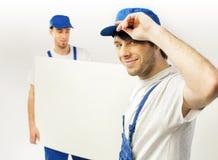 Точная съемка 2 работая работников Стоковые Изображения