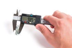 Точное измерение части металла Стоковые Фото