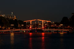 Тощий мост Амстердам к ноча Стоковое Фото