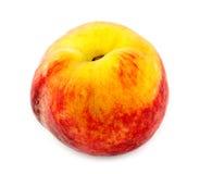 Толстенький, сочный персик изолированный на белизне Стоковые Фото