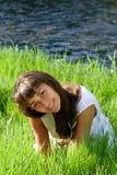 трава девушки около славного реки Стоковое фото RF