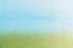 Трава и текстурированная небом предпосылка Стоковые Фото