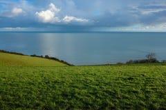 Трава, море, небо Стоковое фото RF