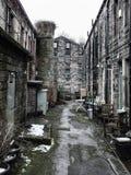 Традиционные дома Западного Йоркшира террасные с каменными кирпичами Стоковое фото RF