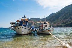Традиционные старые греческие рыбацкие лодки стоковое фото rf