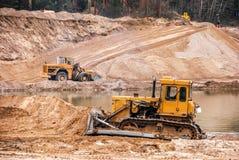 Тракторы в карьере стоковое фото rf