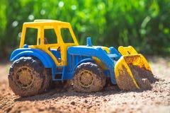 Трактор игрушки в песке Стоковое фото RF