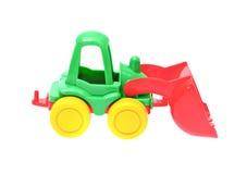 Трактор игрушки изолированный на белой предпосылке Стоковая Фотография