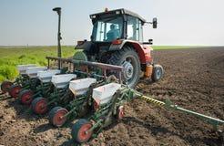 Трактор и сеялка Стоковые Фото
