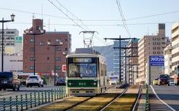 Трамвай бежать на следе в Хиросиме, Японии Стоковые Фотографии RF