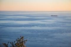 Транспортное судно на заходе солнца Стоковые Фото
