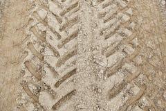 Трассировки катят внутри грязь Стоковые Изображения