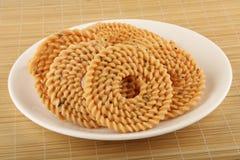 Традиционная индийская закуска - chakali стоковое фото rf