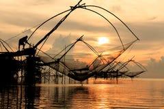 Традиционная рыболовная сеть Азии на восходе солнца Стоковое Изображение