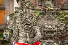 Традиционная статуя предохранителя демона высекла в камне на острове Бали Стоковые Изображения RF