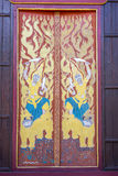 Традиционная тайская картина стиля на деревянной стене Стоковая Фотография