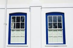 Традиционные голубые окна на белизне Стоковое фото RF