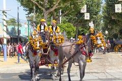 Традиционные экипажи верховой лошади празднуя ярмарку ` s апреля Севильи Стоковые Изображения RF