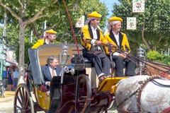 Традиционные экипажи верховой лошади празднуя ярмарку ` s апреля Севильи Стоковая Фотография RF