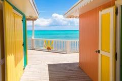 Традиционные яркие карибские дома на береге Стоковое Изображение