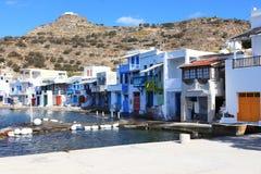 Традиционный рыбацкий поселок на Milos острове, Греции Стоковые Изображения