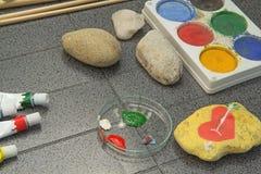 Требования для красить на камне Стоковое Изображение