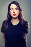 Тревоженая вспугнутая молодая женщина Стоковые Фото