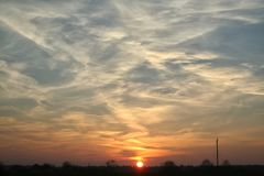 Тревоженый заход солнца Стоковое Изображение