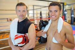 Тренер и студент бокса Стоковые Изображения