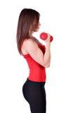 Тренировка девушки с гантелями Стоковое Изображение