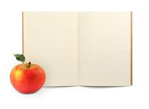 тренировка книги яблока Стоковые Изображения