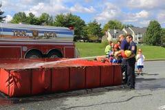 Тренировка пожарного рукава Стоковые Фото