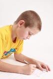 тренировки мальчика книги Стоковые Фото