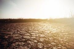 Треснутая земля - изображение концепции Стоковые Фото